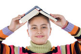 Adorable girl with a book on the head — Stock Photo