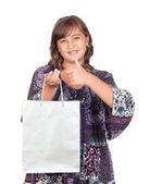 Adorable preteen girl shopping saying OK — Stock Photo