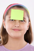 Adorable girl with a note in her front — Stock Photo