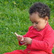 Baby playing on the grass — Stock Photo