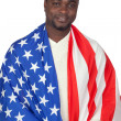 Attractive african man with a American flag — Stock Photo