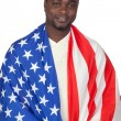 Attractive african man with a American flag — Stock Photo #9500943