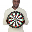 Attractive african man with target — Stock Photo