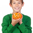 Adorable child with a pumpkin — Stock Photo