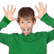 Funny child with green t-shirt mocking — Stock Photo #9501729