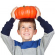 Adorable child with a big pumpkin — Stock Photo