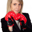 Challenging business woman with boxing gloves — Stock Photo