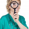 Doctor with magnifying glass — Stock Photo #9502632