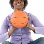 Woman with balloon of basketball — Stock Photo #9503634
