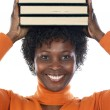 Woman with books on her head — Stock Photo