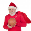 Santa Claus holding a piggybank — Stock Photo #9504097