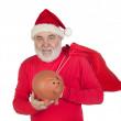 Santa Claus holding a piggybank — Stock Photo #9504097