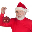 Santa Claus holding a bright ball of Christmas — Stock Photo #9504099