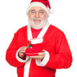 Smiley Santa Claus with a Christmas boot — Stock Photo #9504187