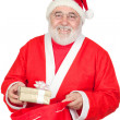 Santa Claus getting a gift from his sack - Stock Photo