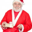Santa Claus getting a gift from his sack — Stock Photo #9504202