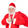 Santa Claus with a full sack saying OK — Stock Photo