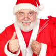 Santa Claus with a full sack saying OK — Stock Photo #9504219