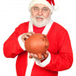 Smiley Santa Claus with piggy-bank — Stock Photo #9504224
