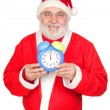 Smiley Santa Claus with alarm clock - Stok fotoraf