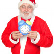 Smiley Santa Claus with alarm clock - Stock Photo