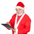 Smiley Santa Claus writing on clipboard — Stock Photo #9504246