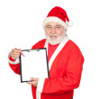 Smiley Santa Claus with a blank clipboard — Stock Photo #9504247