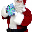 Santa Claus with a gift — Stock Photo #9504274