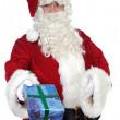 Santa Claus giving a gift — Stock Photo