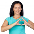 Adorable woman making a heart with the hand — Stock Photo