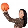 Attractive girl shooting basketball — Stock Photo