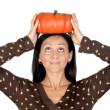 Attractive girl with a big pumpkin — Stock Photo