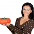 Attractive girl with a big pumpkin — Stock Photo #9506739