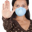 Girl with mask stopping influenza A — Stock Photo #9506828