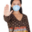 Stock Photo: Girl with mask stopping influenzA