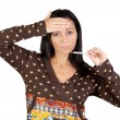 Stock Photo: Sick girl with thermometer