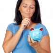 Pensive woman with a blue money-box — Stock Photo #9506935