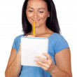 Brunette woman lookin a notebook — Stock Photo