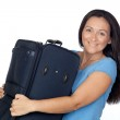 Excited woman with a heavy suitcase — Stock Photo