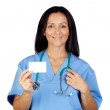 Brunette doctor with a blank card — Stock Photo #9507235