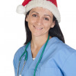 Attractive doctor woman with Christmas cup — Stock Photo #9507335