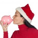 Christmas Girl giving a kiss piggy-bank — Stock Photo #9507374