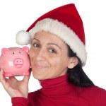 Beautiful girl in Christmas loving moneybox — Stock Photo #9507376