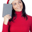 Beautiful girl with Christmas hat and a book — Stock Photo