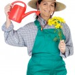 Attractive happy woman dressed gardener — Stock Photo #9507499
