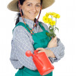 Attractive happy woman dressed gardener — Stock Photo