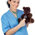 Doctor with a teddy bear — Stock Photo