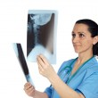 Woman doctor with radiography — Stock Photo #9507547