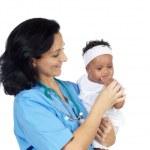 Nurse holding baby — Stock Photo