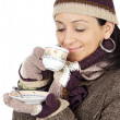 Attractive lady sheltered for the winter drinking a tea cup — Stock Photo #9507842